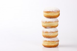 tower of doughnut on white background