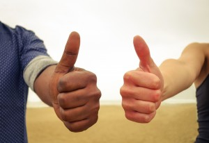 Thumbs up in favor of social equality